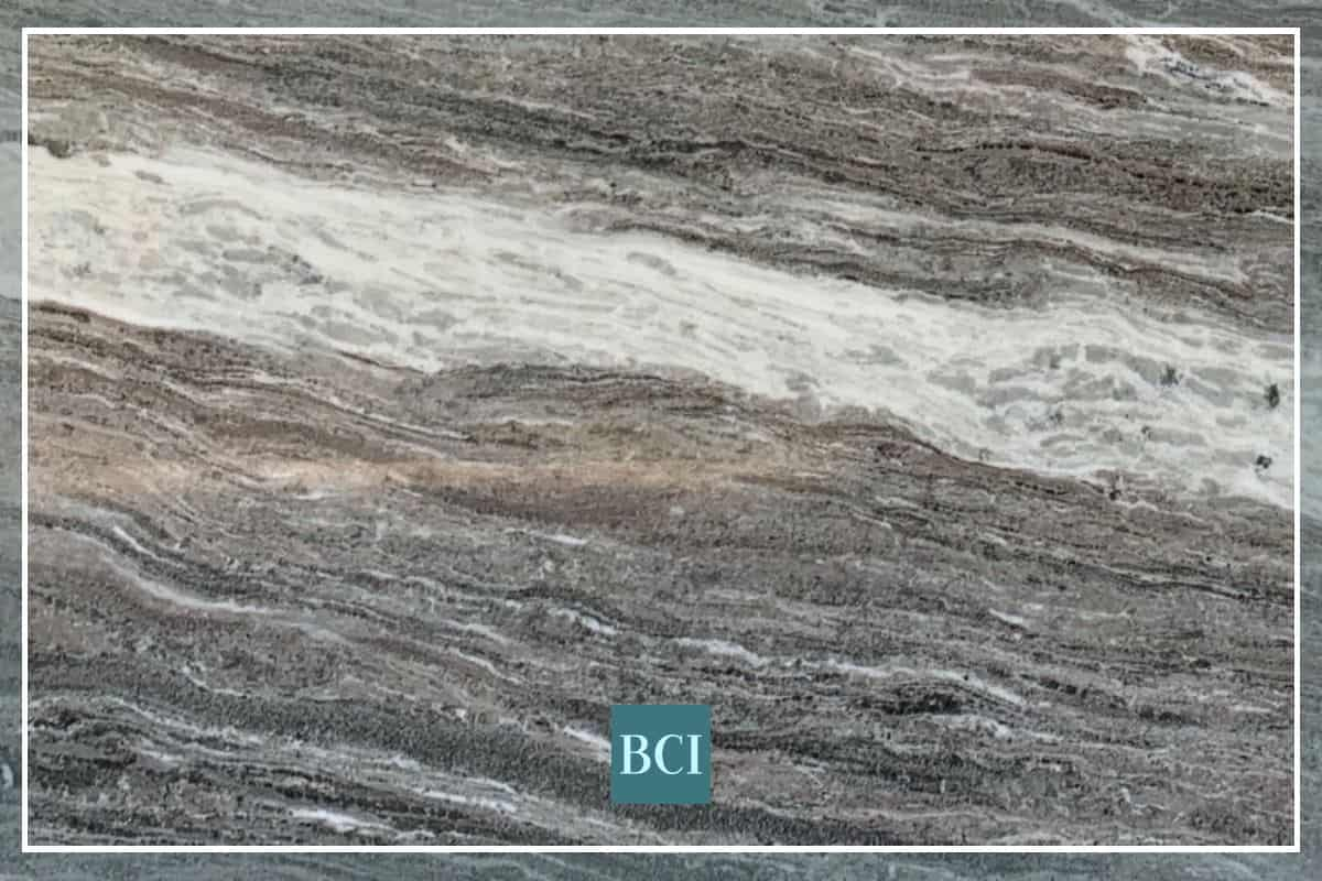 Photo of Fantasy Brown Quartzite countertop slab with shades of cream, tan, and warm grey.