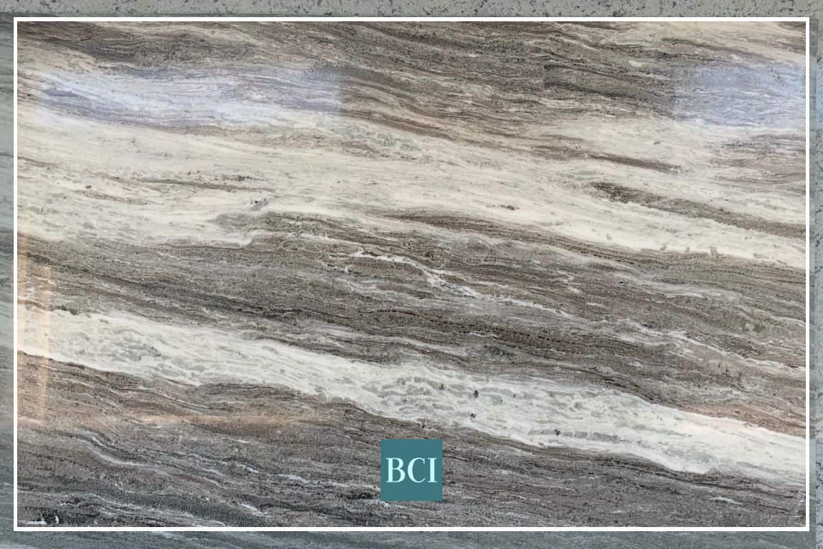 Photo of grey, tan and cream granite kitchen countertop slab.