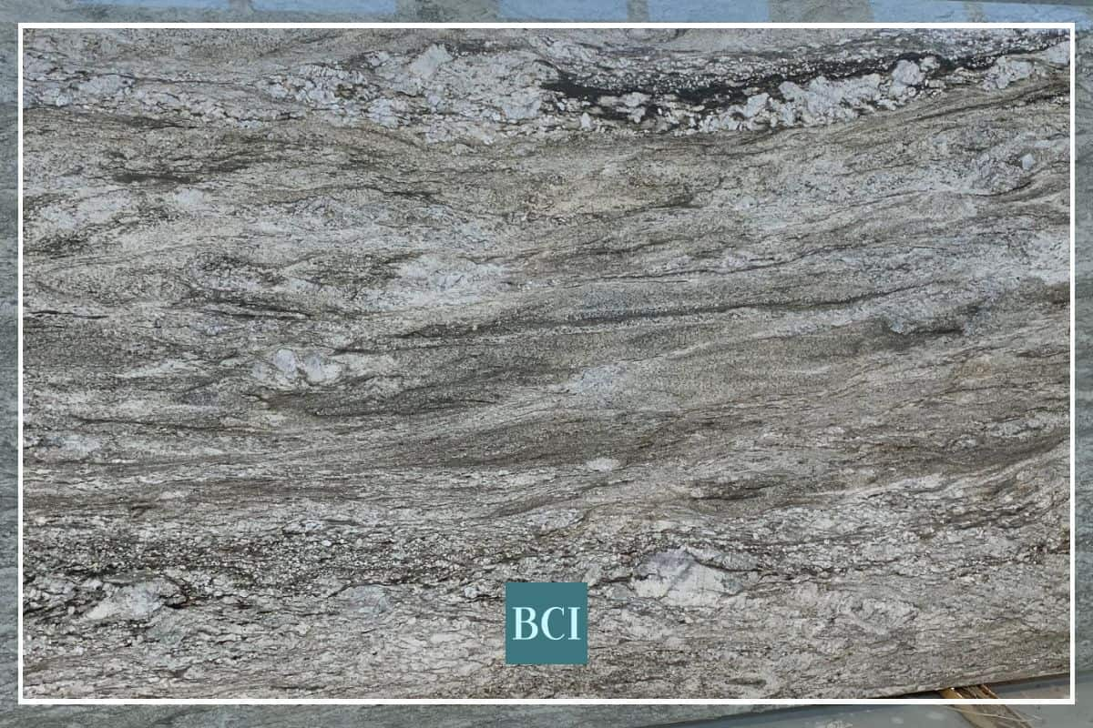 Photo of granite kitchen countertop material  in grey, tans, and black.