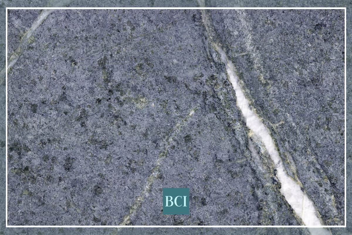 Soapstone countertop material of dark grey background with white veining.